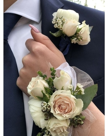 ivory and cream wrist corsage with matching bout. Corsage