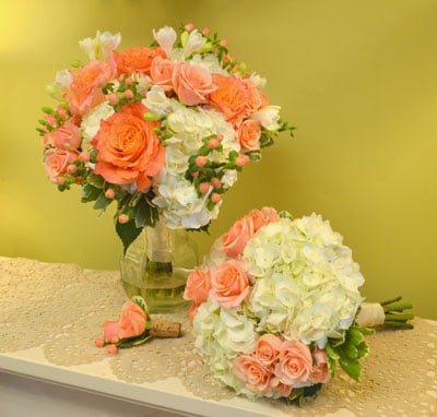 Chester this wedding located at ventosa vineyards in geneva ny had a color scheme of coral peach and white our designers created stunning arrangements using mightylinksfo