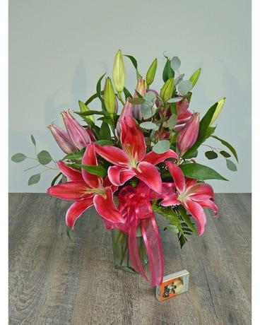 Stargazer Lilies Arranged in a Glass Vase Flower Arrangement