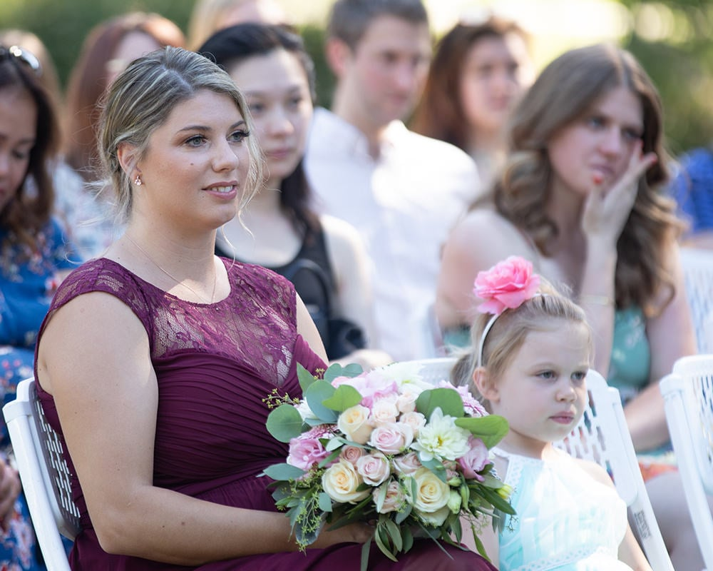 sitting bridesmaid holds the wedding bouquet