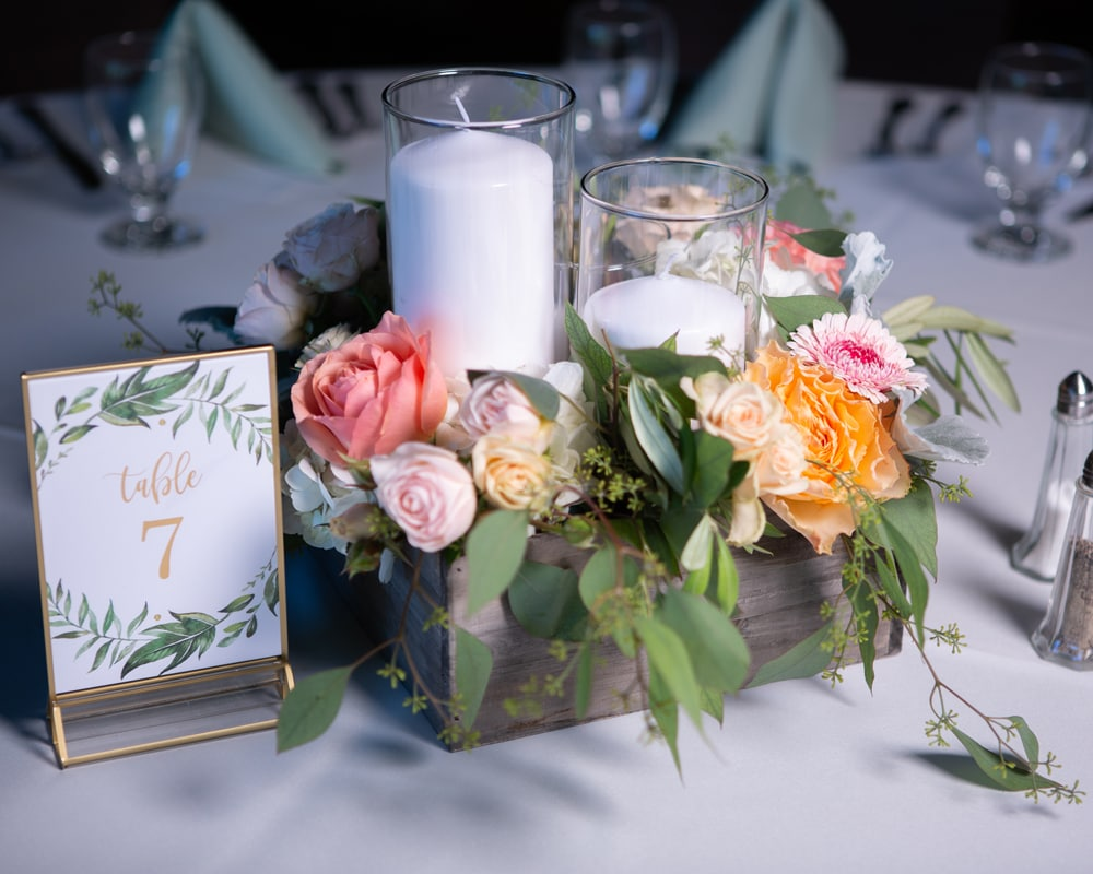 boxed centerpiece with flowers and candles
