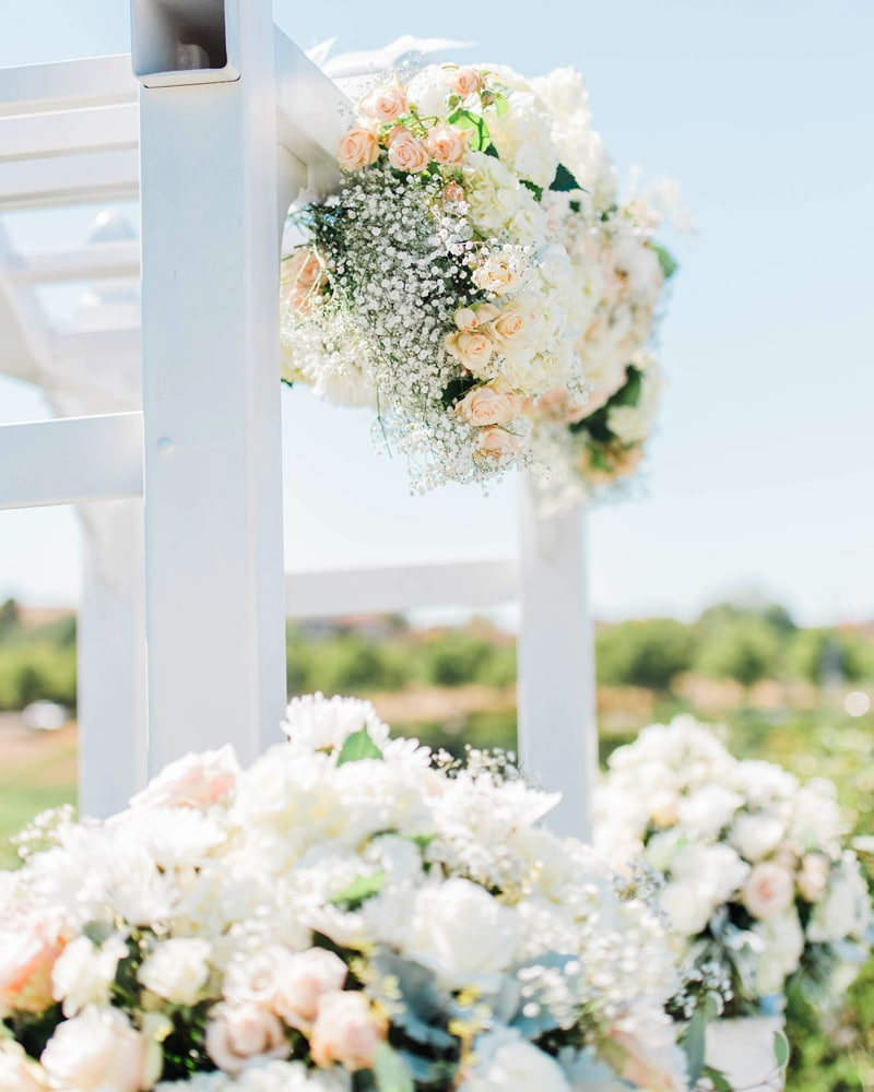 close up image of wedding arch flowers