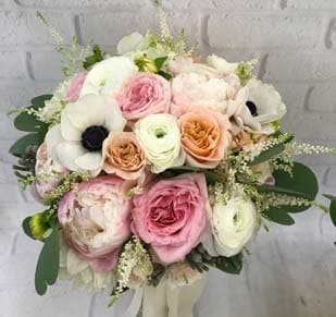 Dreamy bridal bouquets are what we specialize in :)
