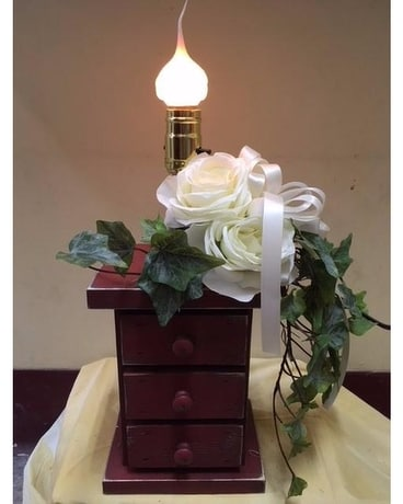 Wooden Chest of Drawers with Silk Flowers Flower Arrangement