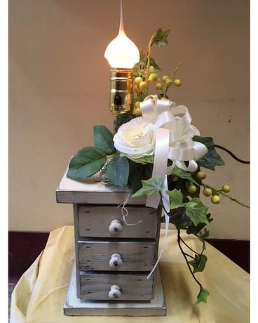 Wooden Chest of Drawers Lamp With Silk Flowers Flower Arrangement