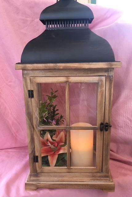 Lantren with timer candle light silk flowers and i Flower Arrangement